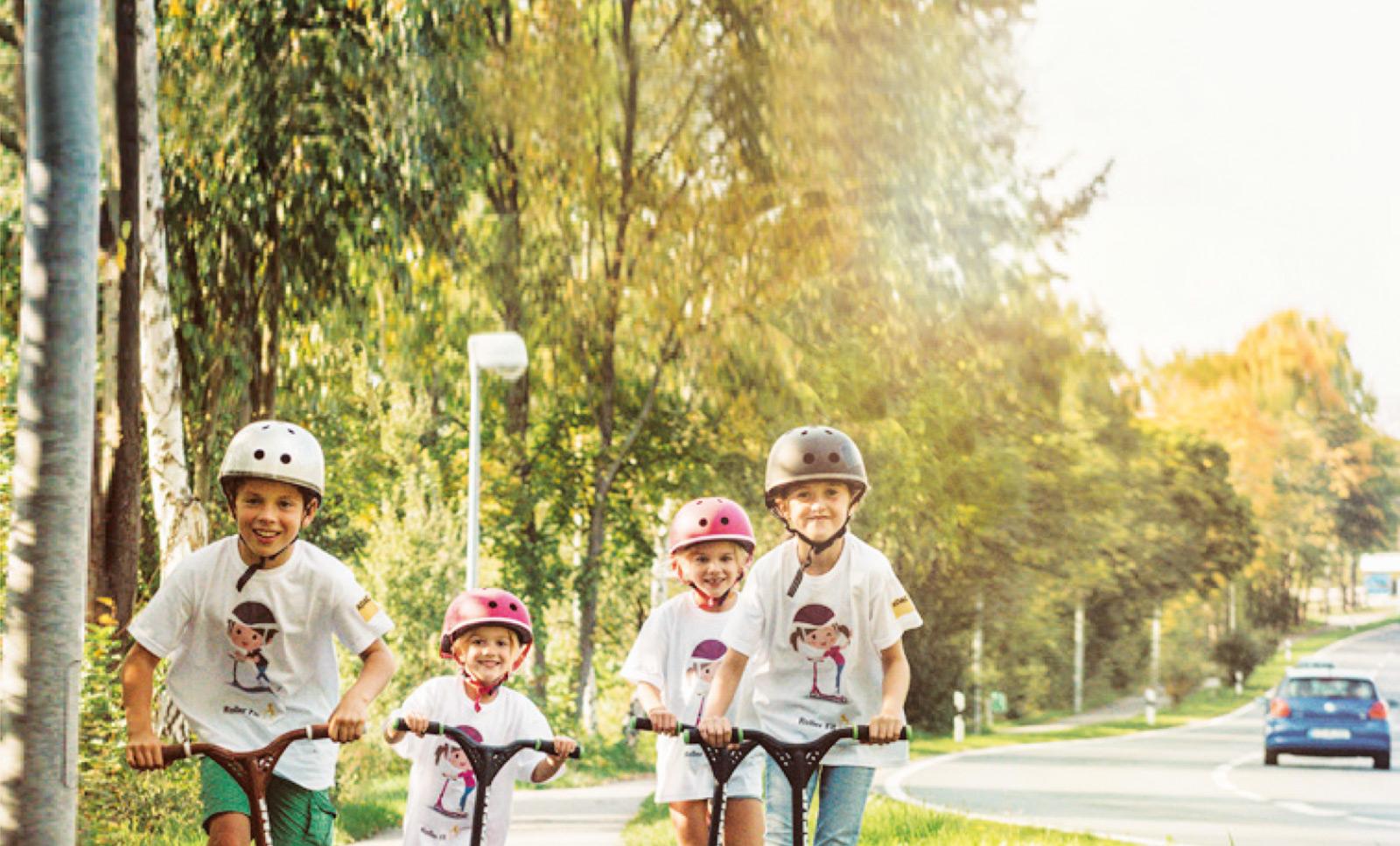 Grundschulkinder mit Roller. Roller Fit! - Trainingsprogramm für Grundschullehrer